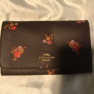 Coach used wallet/wristlet without strap.